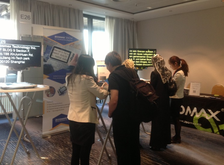 SightCity 2013 visitors trying Zoomax desktop low vision aids