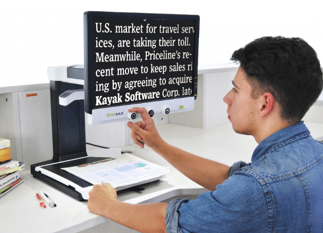 Use Zoomax Panda HD desktop video magnifiers to read books at office