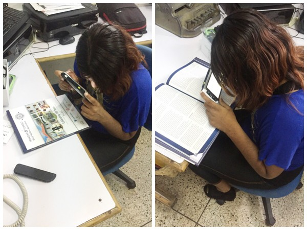 A person from Trinidad and Tobago Blind Welfare Association trying M5 HD Plus video magnifier
