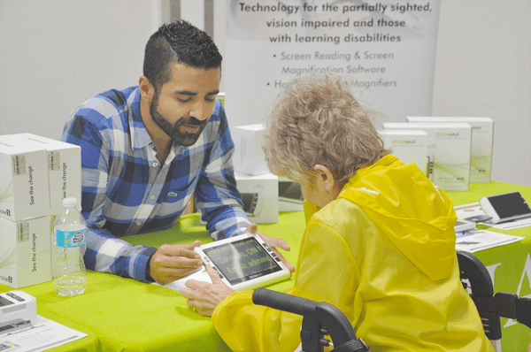 Jad Nohra managing director introducing Zoomax Snow 7 HD Plus to a visitor in the CNIB Simcoe Muskoka 2017
