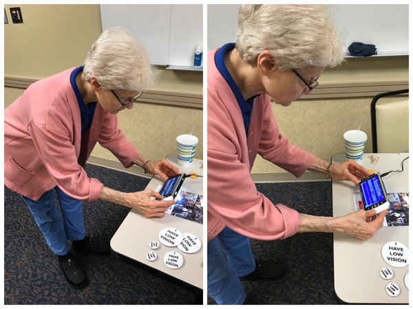 A lady from MDTAP trying Zoomax video magnifier M5 HD Plus in high contrast color