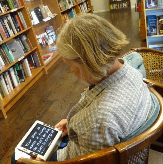 People With Vision Impaired Is Using Handheld Video Magnifier Snow 7 HD For Reading
