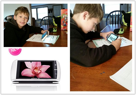 boy using Zoomax touch handheld video magnifier M5 to read and do homework