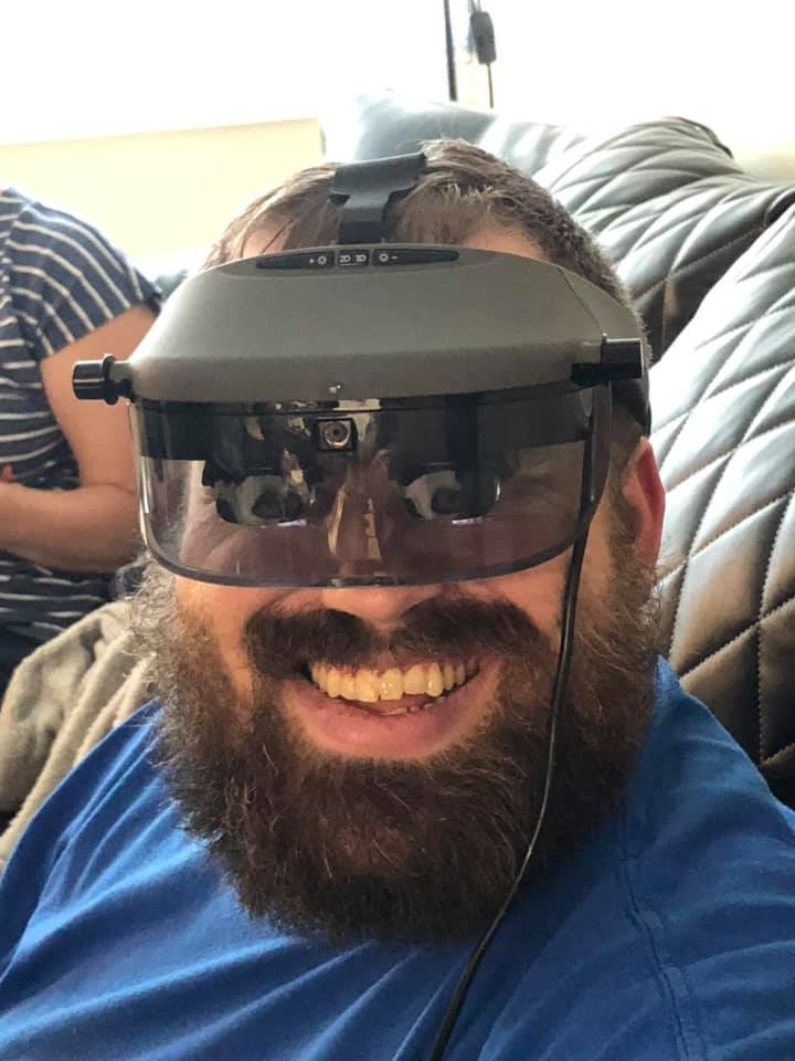 Tanner wearing Acesight electronic glasses for low vision