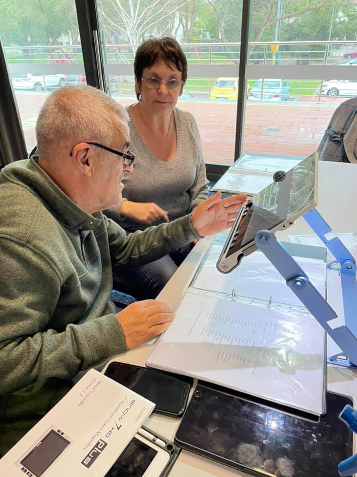 People using Zoomax Snow 12 to read text at Deafblind West Australians